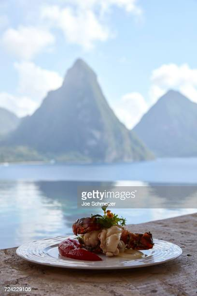 Fresh local lobster dish with view of the Pitons, Saint Lucia, Caribbean