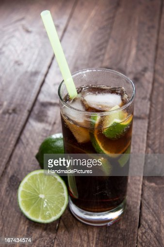 Fresh made Cuba Libre on wood : Stock Photo