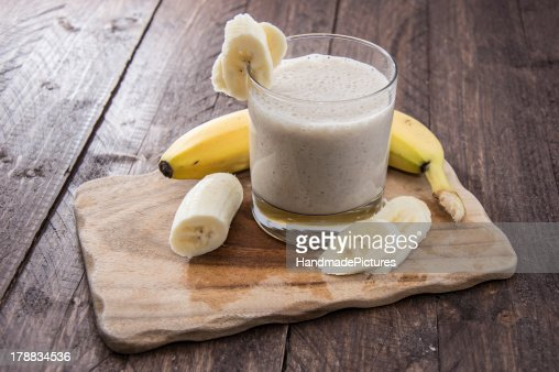 Fresh made milkshake using bananas : Stock Photo