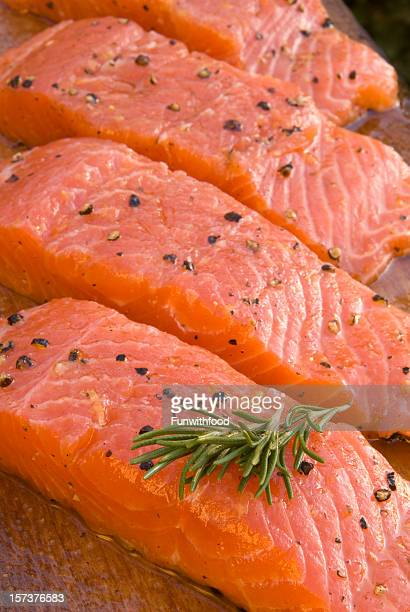 Fresh Marinated Salmon Fish Fillet; Seafood Cooking on Alder Plank
