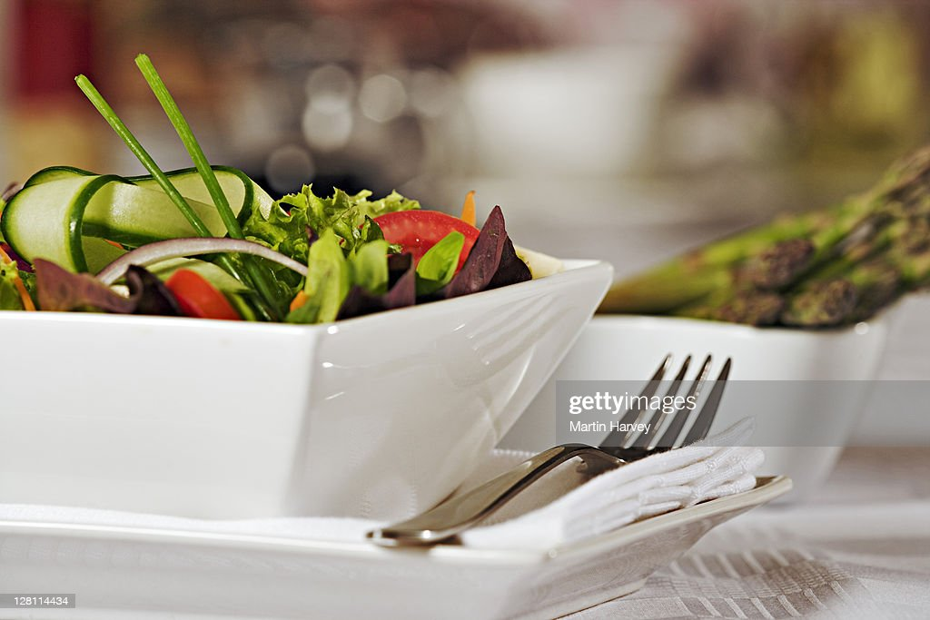 Fresh mixed salad with tomato, red onion, salad leaves, cucumber and cheese in white porcelain bowl. : Stock Photo
