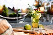Fresh Mojito cocktail in summer on a terrace with bokeh