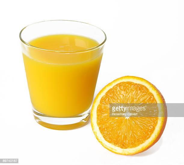 Fresh orange juice with half an orange.