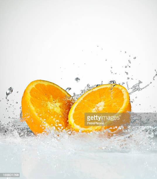 Fresh Oranges. Water Splash. Close-Up.