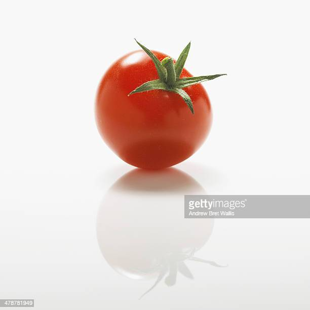 Fresh organic cherry tomato against white