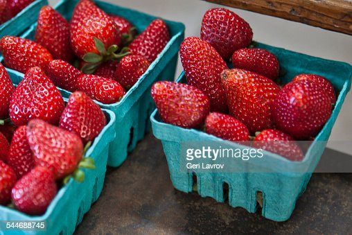 Fresh organic strawberries in cartons