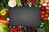 Fresh vegetables on blackboard with copy space.