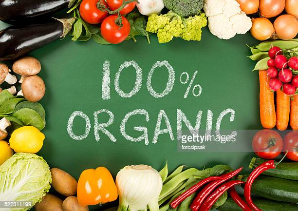 fresh organic vegetables on the 100% organic sign