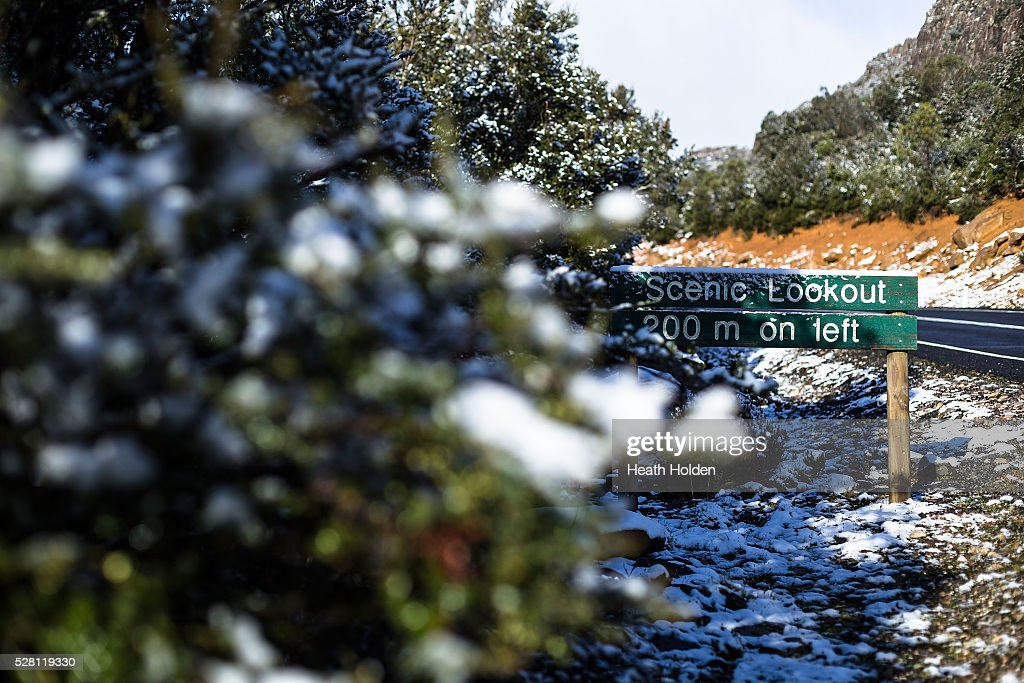 Fesh overnight snowfall lays around the shoreline on May 4, 2016 in Launceston, Australia. Heavy snow and rain fall in the area has seen much needed water flow into the lake. Tasmania's dams are at record lows due to lower than average rainfall with storage levels of dams used to generate hydro power below 15 per cent for the first time.
