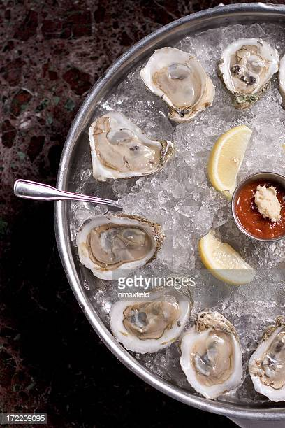 Fresh oysters and lime in a bucket of ice