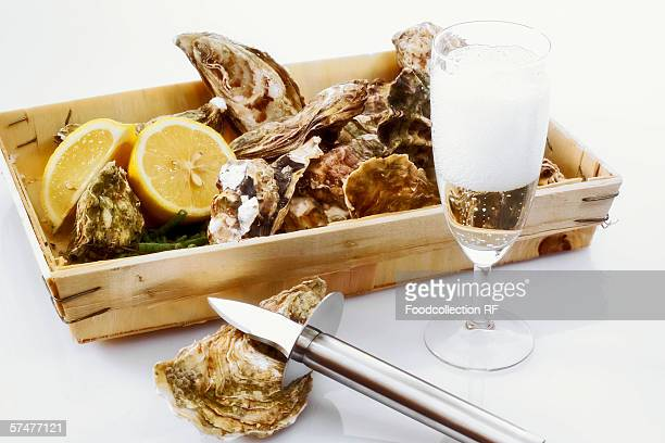 Fresh oysters in a box with a glass of champagne