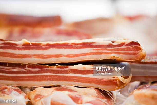A fresh pancetta or an Italian bacon made of pork belly