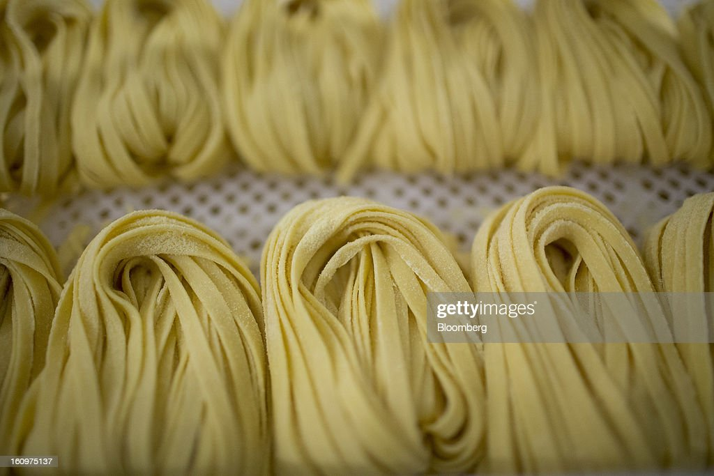 Fresh pasta lays on a tray before being sold at an Eataly location in the Flatiron district of New York, U.S., on Wednesday, Feb. 6, 2013. Eataly is a high-end Italian food market/mall chain, owned by a partnership including Mario Batali, Lidia Bastianich and Joe Bastianich, which first opened in Turin, Italy, in 2007. Photographer: Scott Eells/Bloomberg via Getty Images
