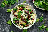 Fresh Pears, Blue Cheese salad with vegetable green mix, walnuts, cranberry. healthy food.
