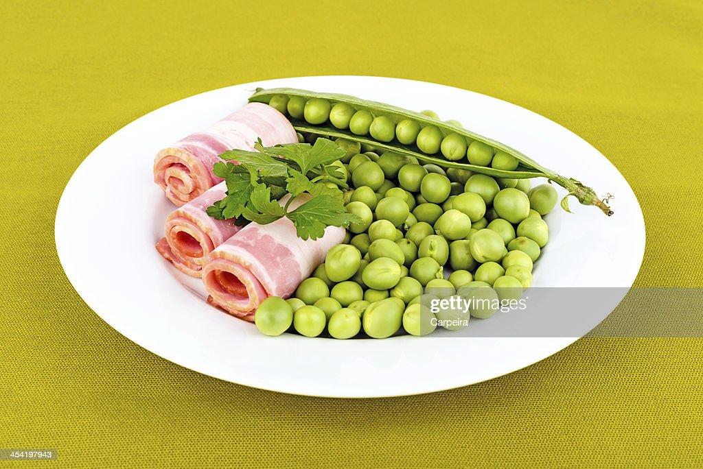 Fresh peas and ham rolls. : Stock Photo