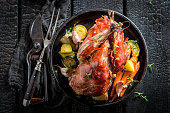 Fresh pheasant with bacon and spices and vegetables