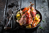 Fresh pheasant with bacon and spices on dark background
