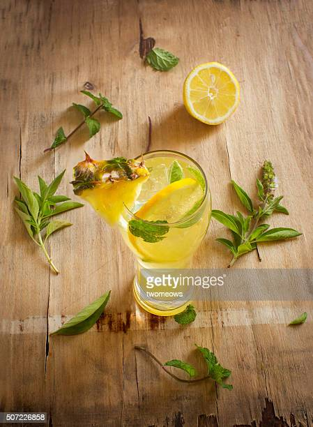 Fresh pineapple and lemon juice with fresh mint and basil leaf.