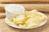 Fresh Potato Chips with Ranch Dip on a background