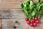 Fresh radishes on wooden table top view