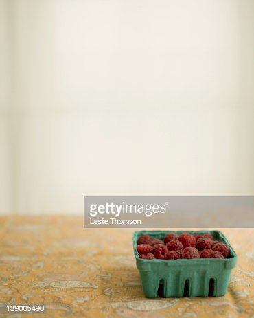 Fresh raspberries in green container : Stock Photo