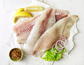 fresh raw bream and seabass fish fillets, top view