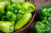 Fresh raw green organic Bell Pepper close up on a wooden background