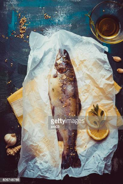 Fresh raw salmon trout fish on paper