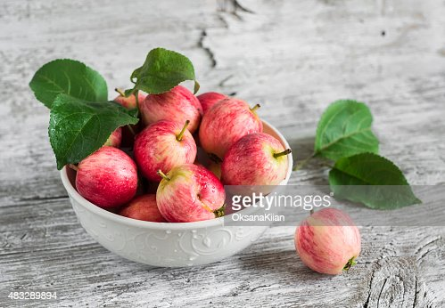 fresh red apples in a white bowl : Stock Photo