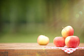 Fresh Yellow Red Apples on Wooden Table