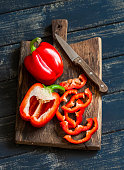 Fresh red sweet pepper on a wooden rustic board