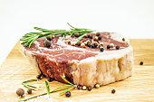 Fresh rib eye steak with rosemary and pepper