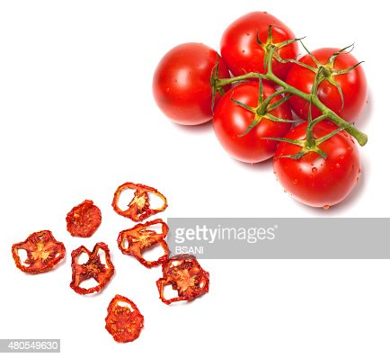 Fresh ripe and dried tomatoes slices : Stock Photo