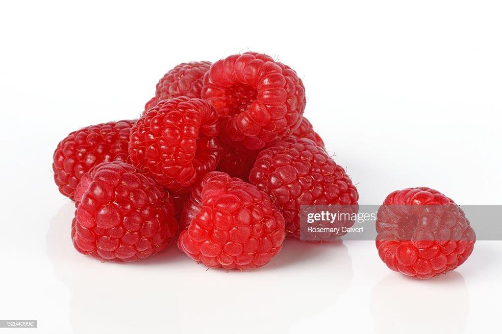 Fresh, ripe raspberries in a pile.