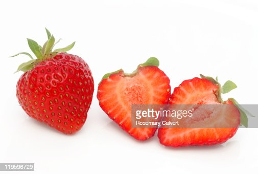 Fresh ripe strawberries, one cut into halves. : Stock Photo