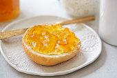 Fresh roll with orange marmalade