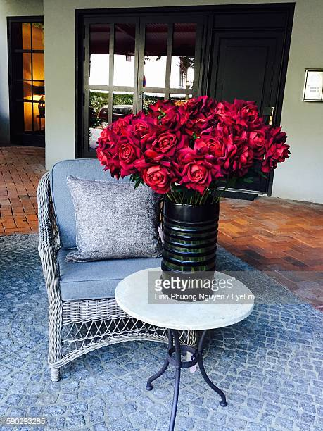 Fresh Rose Pot On Stool By Armchair At Home