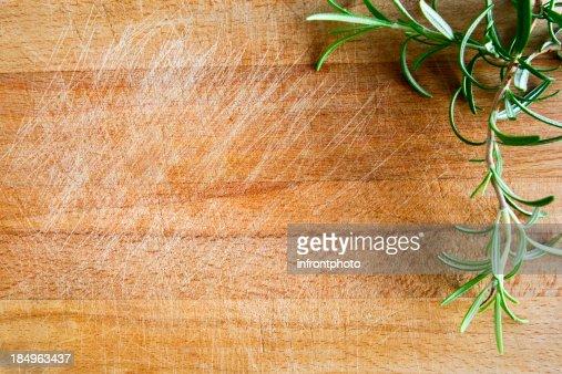 Fresh rosemary on a wood chopping board