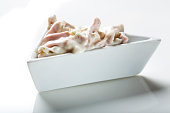 Fresh salad in bowl made from meat and mayonnaise on white