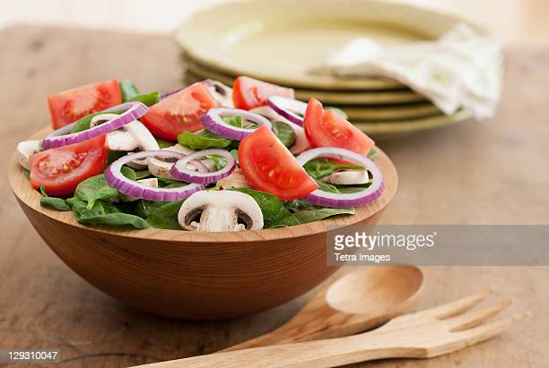 Fresh salad in bowl on table