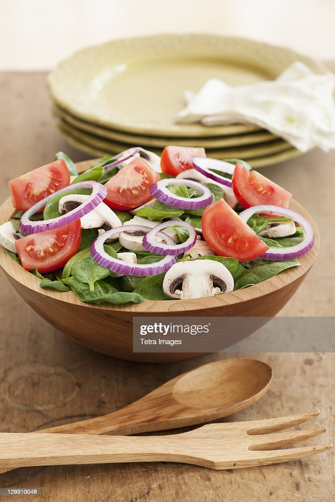 Fresh salad in bowl on table : Stock Photo