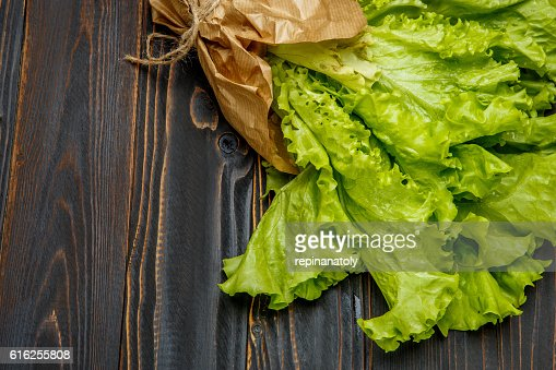 Fresh salad lettuce on wooden background : Stock Photo