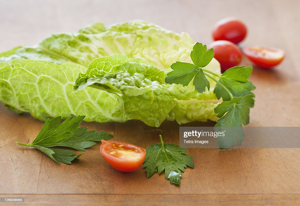 Fresh salad on cutting board : Stock Photo