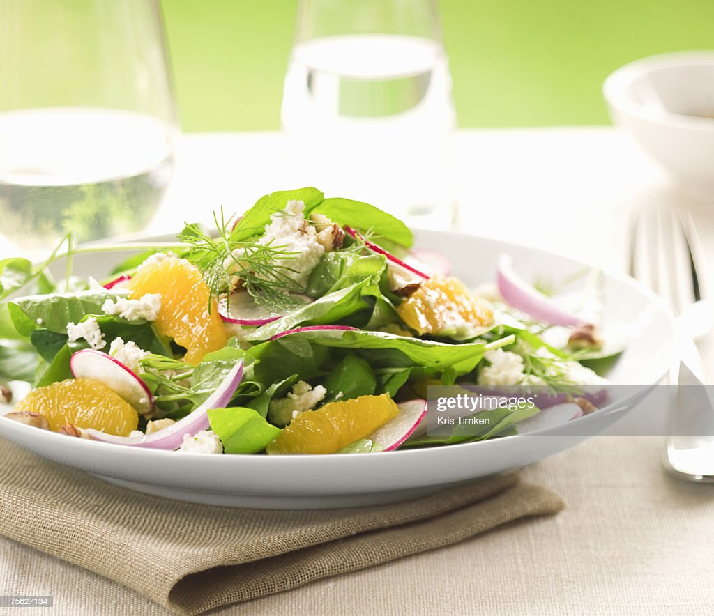 Fresh salad on plate outdoors, close-up : Stock Photo
