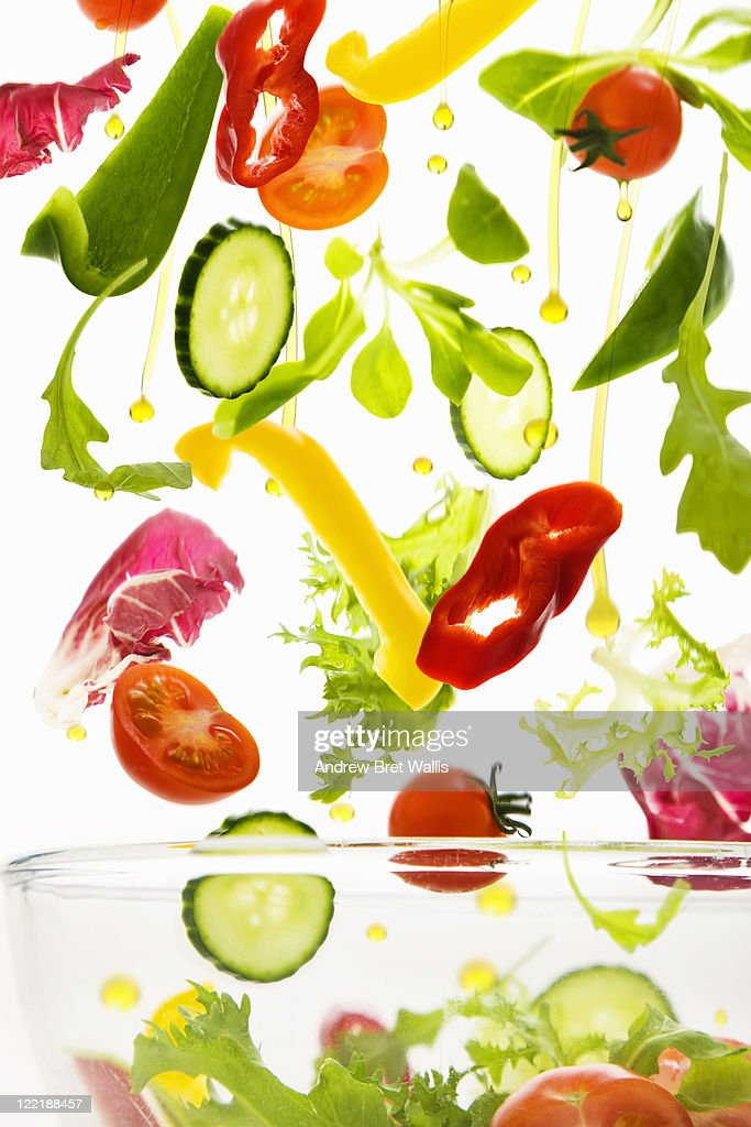Fresh salad vegetables with olive oil : Stock Photo