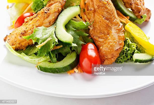 Fresh salad with grilled Tandoori-style chicken