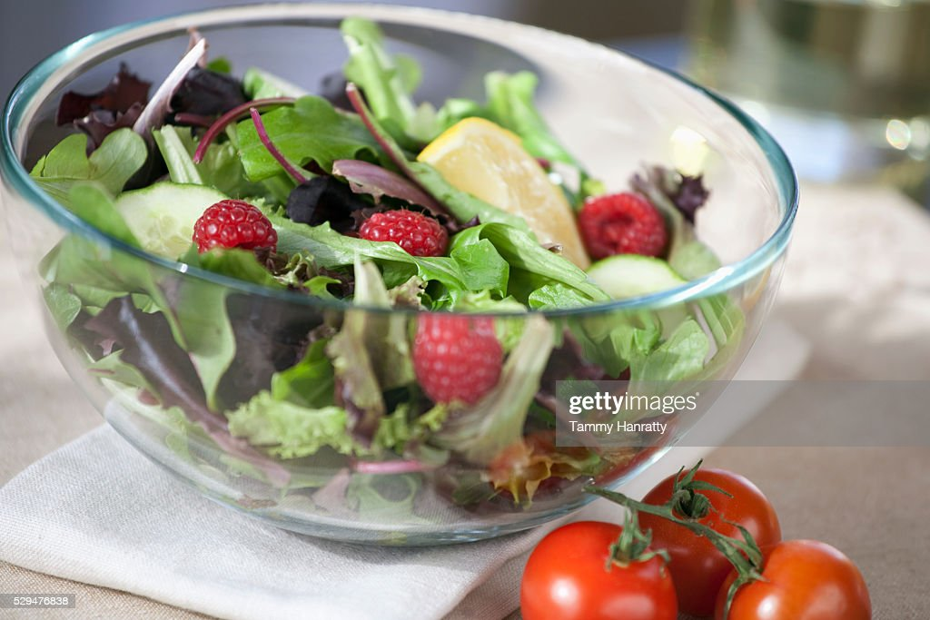Fresh salad with raspberries and lemon : ストックフォト