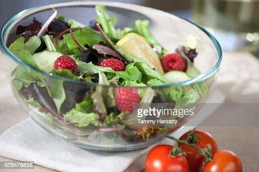 Fresh salad with raspberries and lemon : Stock Photo