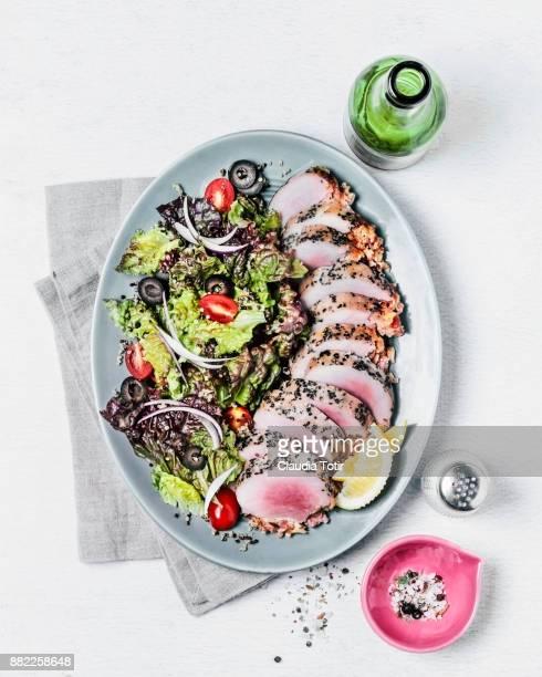 Fresh salad with roasted pork loin