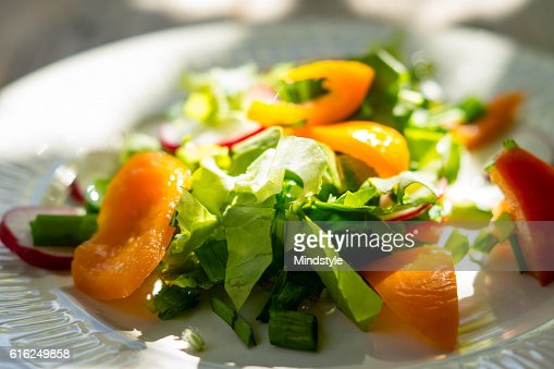 Fresh salad with summer vegetables on the wooden table : Foto de stock